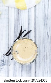 Fresh made Vanilla Milk (close-up shot) on wooden background