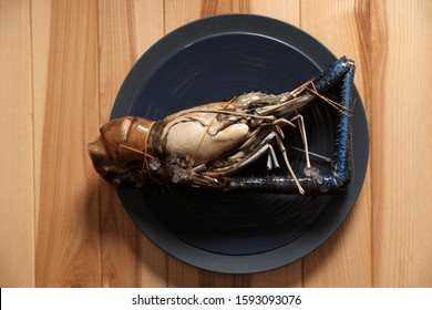 Fresh malaysian freshwater prawn on wooden table, top view