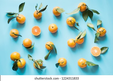 Fresh mandarin isolated on blue punchy pastel. Flat lay. Top view. Fruits pattern.