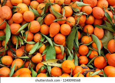 Fresh mandarin oranges or tangerines on a stack at the greengrocer