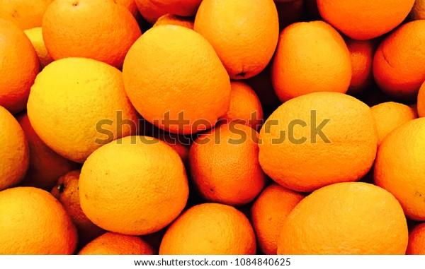 Fresh mandarin oranges texture. Bunch of fresh mandarin oranges on market, Stack of mandarins, Lot of Mandarin Oranges, Pile of a Fresh Mandarin Oranges for Background
