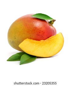 fresh mango fruit with cut and green leafs isolated on white background