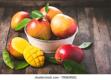 Fresh mango fruit on the wooden background