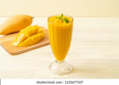 fresh mango smoothies - healthy food and drink concept
