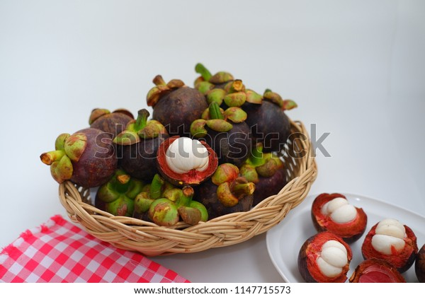 Fresh mangosteen in basket on white background