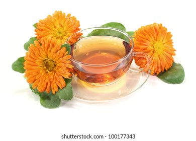 fresh marigold tea with flowers and leaves on a bright background