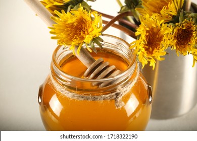 fresh may honey is on the table next to herbs