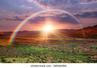 Fresh meadow sunrise in the Valley against rainbow