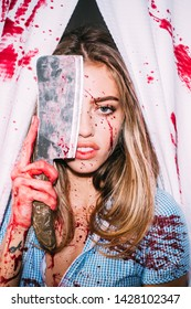 Fresh meat. Sexy girl killer. Halloween festival. Fear and horror. Steak concept. Meat food. Murderer tender girl. Bloody prey. Bloody female. Woman with blood on face holding bloody cleaver and meat.