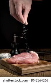 Fresh meat steaks on wooden cutting board