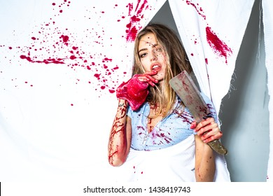 Fresh meat. Woman with blood on face holding bloody cleaver and meat. Sexy girl killer. Halloween festival. Fear and horror. Steak concept. Meat food. Murderer tender girl. Bloody prey. Bloody female.