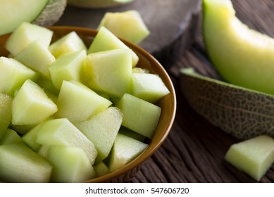 Fresh melon sliced on wooden table.