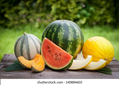 Fresh melons on wooden ground