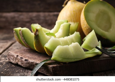 Fresh melons sliced on wooden table ,healthy food