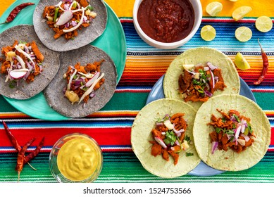Fresh Mexican tacos on table with chili sauce