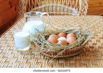 fresh milk and some eggs in the basket