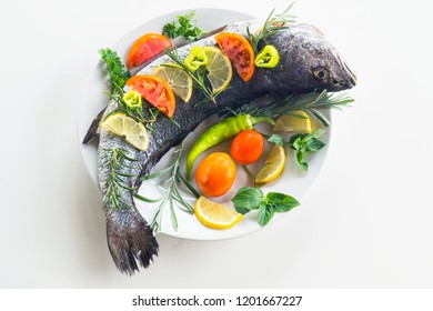 Fresh milokopi with vegetables and lemon