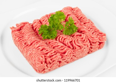 fresh mince with herbal on white plate