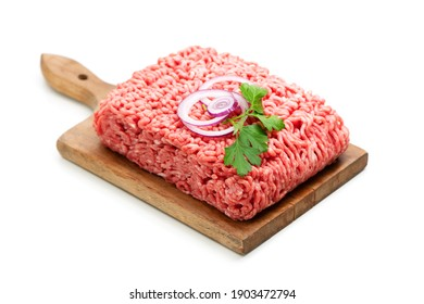 Fresh minced meat garnished with onions, pepper and parsley. Isolated on white background