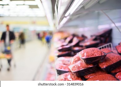 Fresh mincemeat packaged laid out on shelf of supermarket