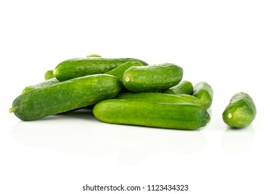 Fresh mini cucumbers heap isolated on white background