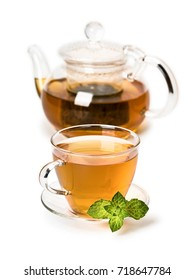 Fresh mint and green tea in cup and teapot from glass, it is isolated on white