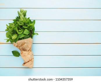 Fresh mint leaves herb on wooden table. Top view with copy space
