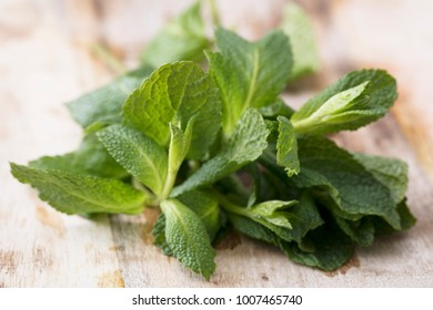 Fresh mint leaves on rustic wooden surface