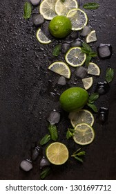Fresh mint, lime and ice on a black background. Ingredient for mahito. Top view