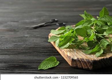 Fresh mint on wooden board, closeup