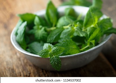 Fresh mint in a rustic metal bowl