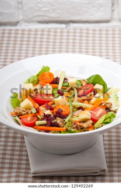 Fresh mixed colorful healthy salad closeup vegetarian food