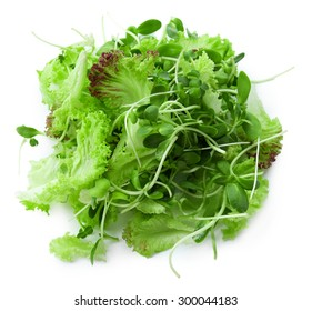 Fresh mixed green salad isolated on white