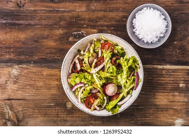 Fresh mixed salad with tomatoes, top view
