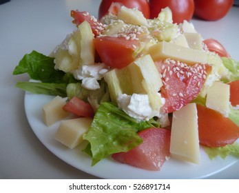 a fresh mixed vegetable salad with cheese