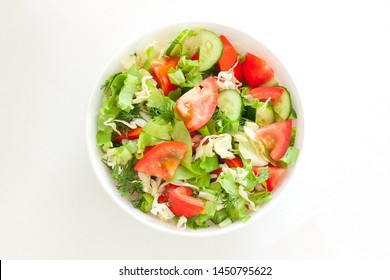 Fresh mixed vegetables salad in a bowl. Raw salad in white bowl on white background - Shutterstock ID 1450795622
