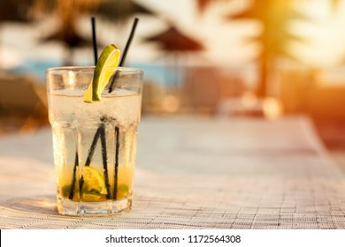 Fresh mojito cocktail on white wooden table