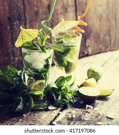 fresh mojito on a rustic table/ summer drink background