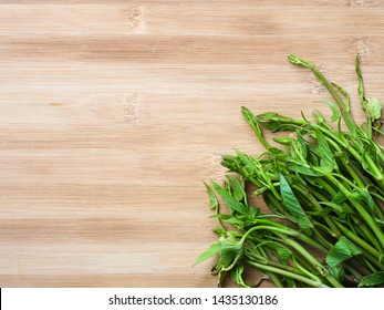 Fresh morning glory on wooden background, Top view with copy space, Vegetable concept.