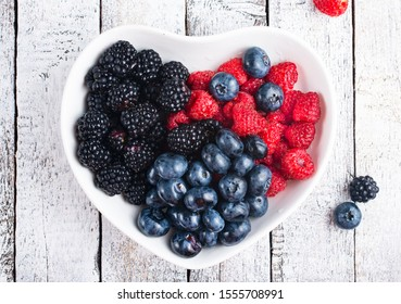 fresh mox berries in white bowl on  a table