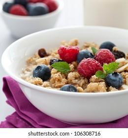 fresh muesli with fruits and milk