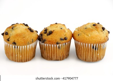 fresh muffins isolated on white background