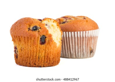 Fresh muffins. Whole, and with a piece bitten off isolated on white background