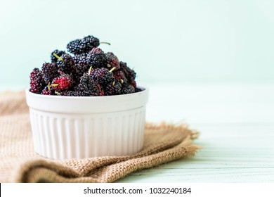 fresh mulberry bowl on wood table