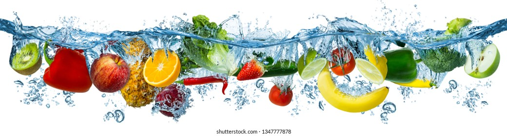 fresh multi fruits and vegetables splashing into blue clear water splash healthy food diet freshness concept isolated on white background