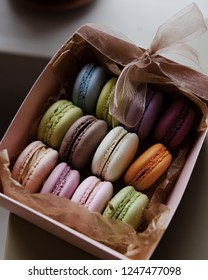 Fresh multicolored french macarons in a gift box.