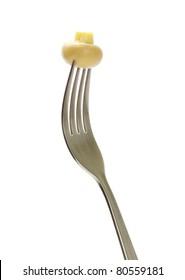 Fresh mushroom on a fork isolated on white background