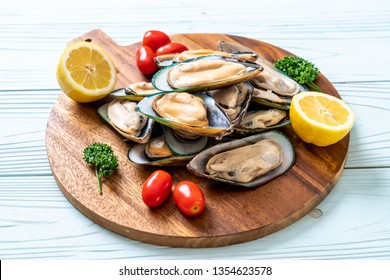 fresh mussel on wood board with ingredients
