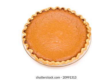 Fresh from my oven.  Home made pumpkin pie on white background.
