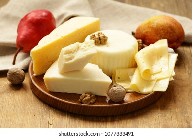 fresh natural assorted cheese board with aromatic pears